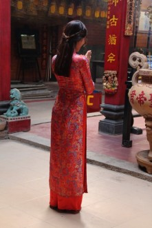 Local girl posing for pictures in Chinese temple